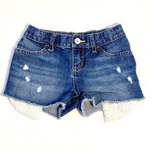 Place distressed denim shorts 6